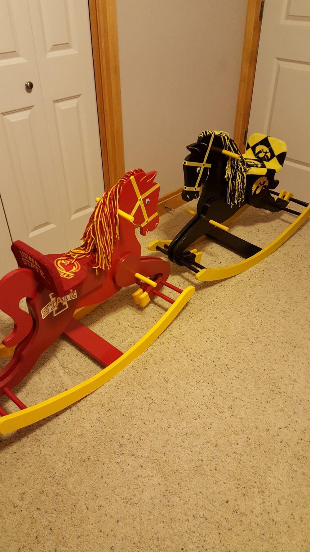 ISU and Iowa rocking horses.