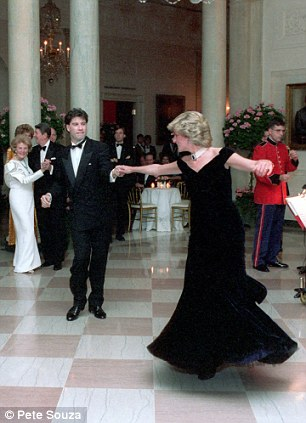 "1985 - Reagan Administration - John Travolta and Princess Diana dance to music from ""Saturday Night Fever"". Her dress was later called the Travolta dress."