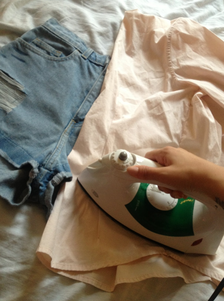 Once it has all fully dried, place your piece of unwanted fabric over the denim and apply heat from your iron for about 5 to 10 minutes. Make sure you add heat to every single spot, so remember where you've applied the product as it will dry clear.