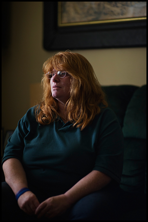 """It's not a choice I wanted for myself,"" said Lori Cole, 51 of Bowling Green. 30 years ago she walked into an abortion clinic and says she can still see and hear everything about the experience. A year into a new marriage, Cole was pressured into the decision by her then husband who said the child would put to much strain on the couples finances. Here she poses for a portrait at her home on Thursday, May 1, 2014. Photos by Brian Powers"