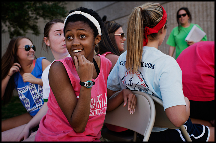 Omega Phi Alpha freshman Brittni Thomas from Raleigh, NC looks back at her sorority sisters after claiming a seat during musical chairs at Greek Week Events day at the Colonnade on WKU's campus on Thursday, April 10, 2014. This years events included the 40 yard dash, Ball Race, Sack Race, Egg Spoon Race, Egg Toss, Musical Chairs, and the Penny Toss. Photos by Brian Powers