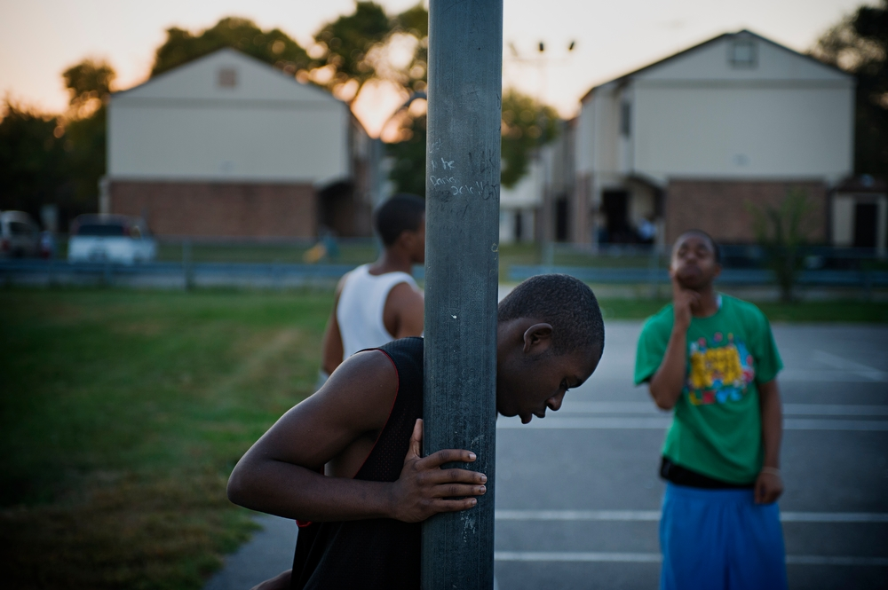 Young men prove themselves on the basketball courts next to Jericho Circle.