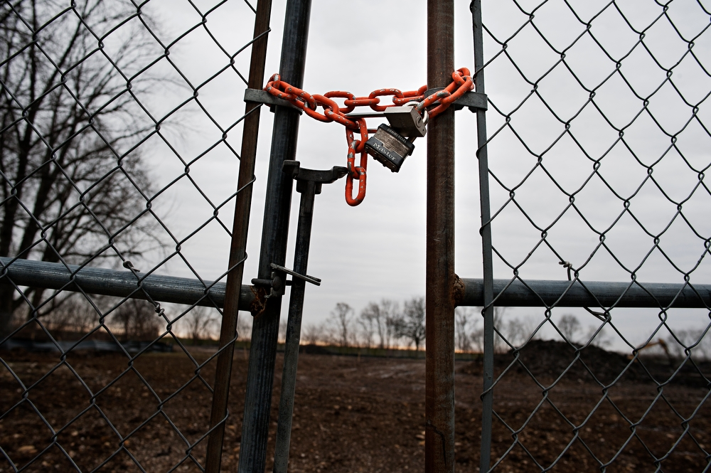 Locks hang on the fences that surround the land that used to be Jericho Circle in Aurora on Wednesday, January 17, 2013. The city and housing authority remain deadlocked on what is to become of the land that over 90 families used to call home.