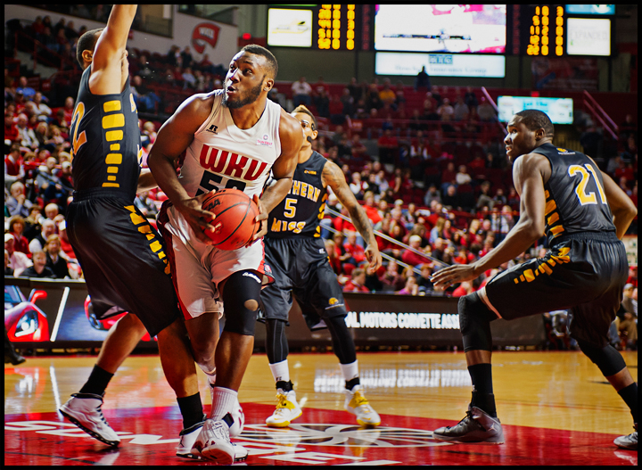 WKU's T.J. Price drives to the net against Aaron Brown of Southern Miss at E.A. Diddle Arena on Wednesday, December 18, 2013. The Hilltoppers would go on to win 68-65. Photos by Brian Powers