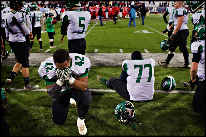 Meade County's Antwan Ferguson, left, cries after loosing the state champion ship game to Scott County, 21-14, during the KHSAA Gridiron Bowl 6A state championship at Western Kentucky University in Bowling Green on Saturday, December 7, 2013. Photo by Brian Powers