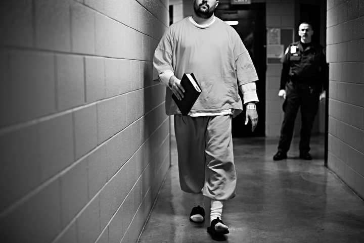 Under the close surveillance of the jail guards, Joseph Walker makes his way to church services at the Warren County Regional Jail on Sunday, Nov. 10, 2013. Photos by Brian Powers