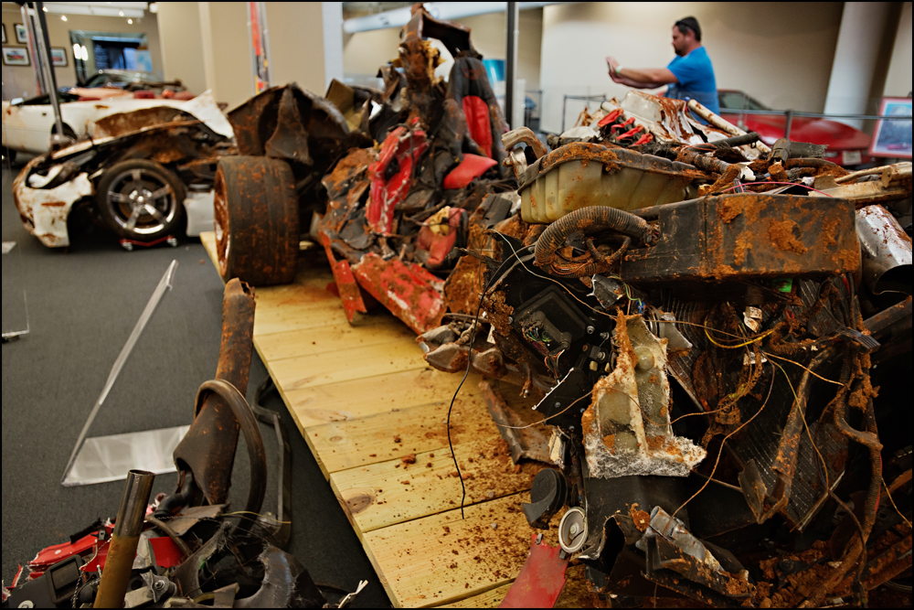 The 2001 Mallett Hammer Corvette that was on display in the Skydome at the National Corvette Museum sits on display in the condition that it was removed from the sinkhole in on Wednesday, June 25, 2014. Photo by Brian Powers