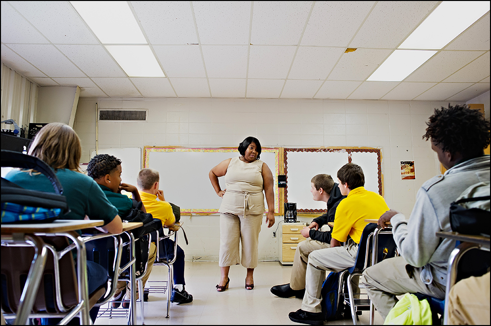 Special Education teacher Katrina Wiley talks to her students on the first day of classes at H.W. Byers High School in Holly Springs, Miss. on Monday, August 11, 2014. Wiley said she believes the new written portion of the Common Core tests will be the hardest for her students who are used to the traditional multiple choice answers to questions. Photos by Brian Powers