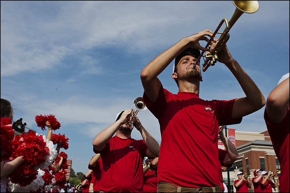 Aug 29, 2014; Bowling Green, KY, USA; The Western Kentucky Hilltoppers Marching Band parades down Avenue of Champions the the schools campus before their opening football game against the Bowling Green Falcons at Houchens Industries-L.T. Smith Stadium. Mandatory Credit: Brian Powers-USA TODAY Sports