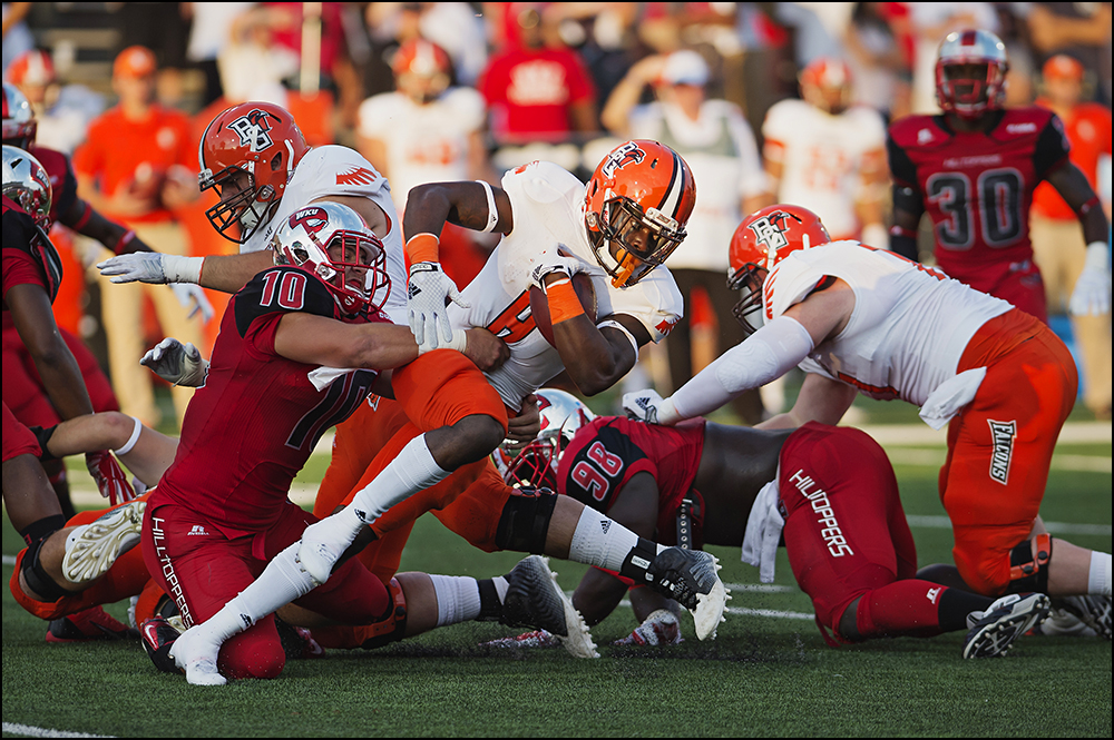 Aug 29, 2014; Bowling Green, KY, USA; Bowling Green Falcons running back Travis Greene (8) is tackled by Western Kentucky Hilltoppers linebacker Nick Holt (10) during their game at Houchens Industries-L.T. Smith Stadium. Mandatory Credit: Brian Powers-USA TODAY Sports