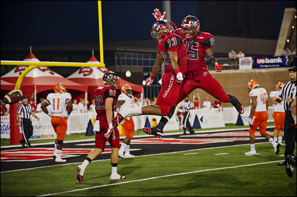 Aug 29, 2014; Bowling Green, KY, USA; Western Kentucky Hilltopper wide receivers Antwane Gant (13) and Nicholas Norris (15) celebrate a touchdown to take the lead 20-0 in the second quarter over the Bowling Green Falcons at Houchens Industries-L.T. Smith Stadium. Mandatory Credit: Brian Powers-USA TODAY Sports