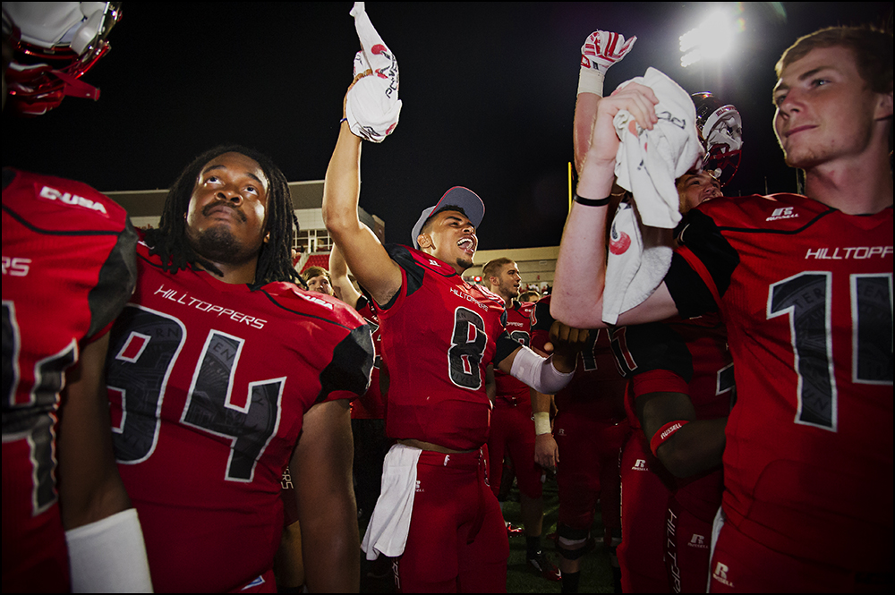 Aug 29, 2014; Bowling Green, KY, USA; Western Kentucky defensive lineman Bryan Shorter (94), defensive back Marcus Ward (8),  defensive back Juwan Gardner (14) celebrate in front of the school band after defeating the Bowling Green Falcons 59-31at Houchens Industries-L.T. Smith Stadium. Mandatory Credit: Brian Powers-USA TODAY Sports