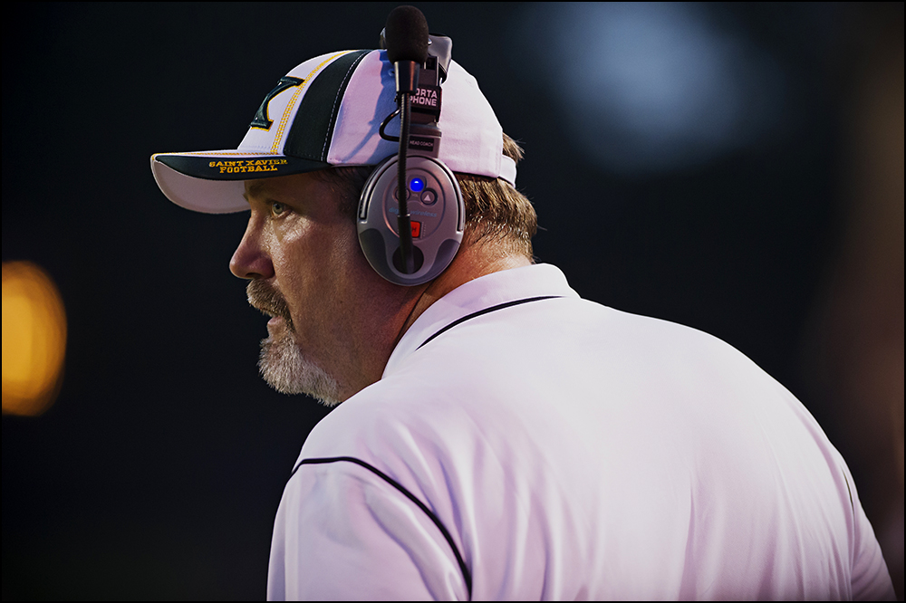 St. Xavier coach Will Wolford watches his team from the sideline during the Tigers game against Bowling Green at Bowling Green High School on Friday, September 5, 2014. The Tigers would go on to loose 6-0 in overtime. Photos by Brian Powers