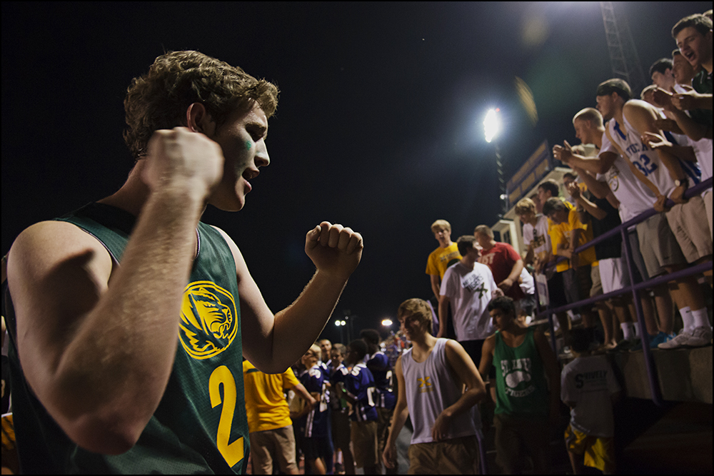 St. Xavier senior Connor Crush, from Louisville, cheers with the rest of the St. Xavier student section during the Tigers game against Bowling Green at Bowling Green High School on Friday, September 5, 2014. The Tigers would go on to loose 6-0 in overtime. Photos by Brian Powers
