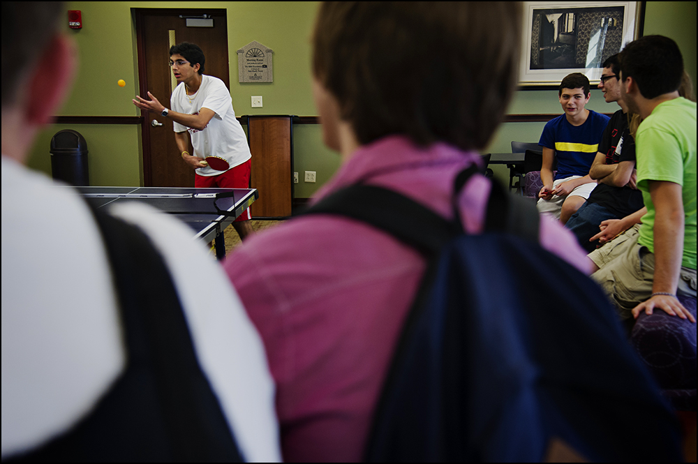 Gatton Academy students watch as Nitin Krishna, top left, from Knox County, Ky. serves during a game of ping-pong with Harsh Moolani, a junior from Davis County, not pictured, at the Academy on the campus of Western Kentucky University in Bowling Green, Ky. on Monday, September 9, 2014. Krishna graduated from the academy last year and was the reigning ping-pong champion. Gatton Academy has been named the number one public school in the country for the third year in a row by The Daily Beast. Photo By Brian Powers, Special to the CJ, 09/08/2014