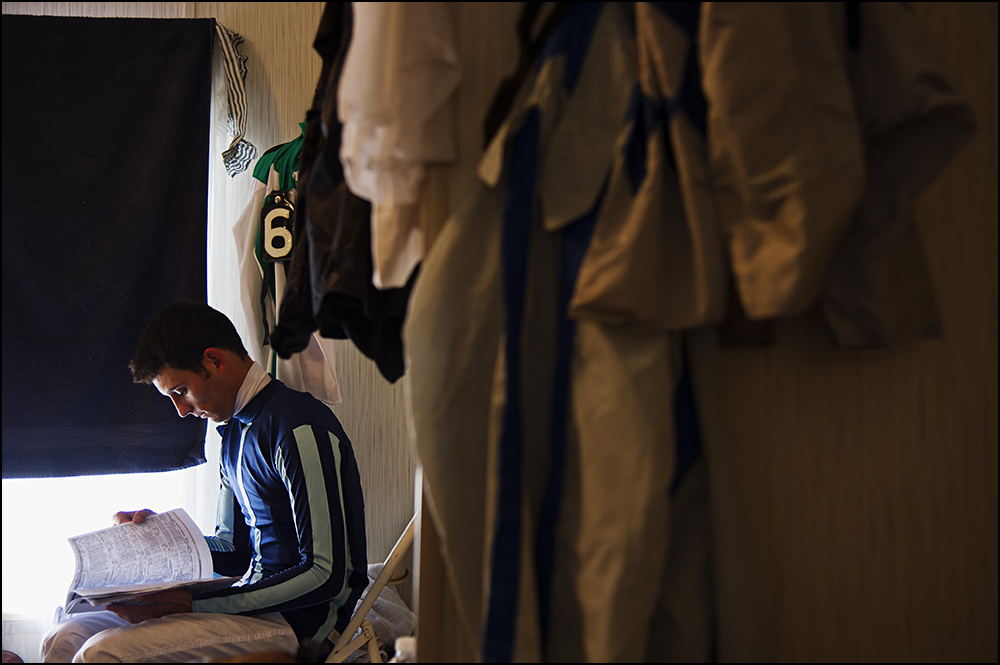 26 year old jockey Chris Landeros, from California, looks over the race sheet while preparing for his third race of the day at Kentucky Downs race track in Franklin, Ky. on Wednesday, September 10, 2014. By Brian Powers, Special to the CJ, 09/08/2014