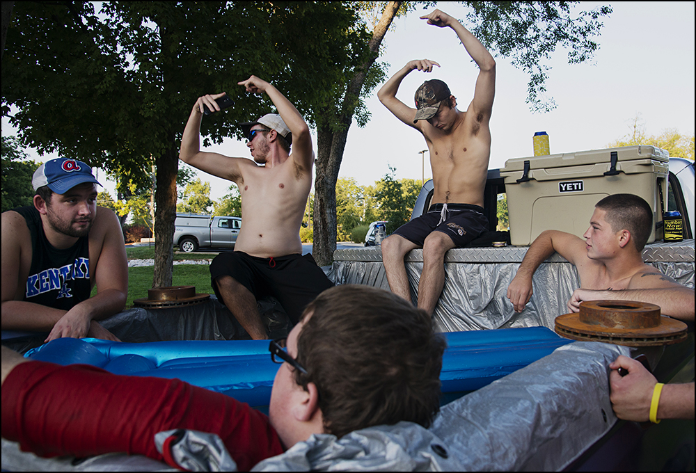 Members of the Alpha Gamma Row fraternity relax in a makeshift pool in the back of a truck just of the campus of WKU in Bowling Green, KY on Friday, September 5, 2014. Photos by Brian Powers