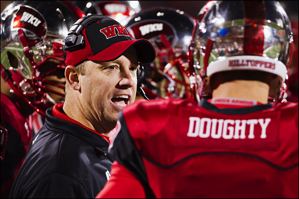 Nov 8, 2014; Bowling Green, KY, USA; Western Kentucky University head coach Jeff Brohm talks to quarterback Brandon Doughty in the fourth quarter of their game against UTEP at Houchens Industries-L.T. Smith Stadium. WKU would go on to win 35-27. Mandatory Credit: Brian Powers-USA TODAY Sports
