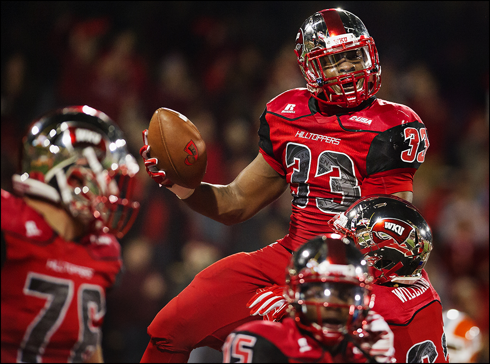 Nov 8, 2014; Bowling Green, KY, USA; Western Kentucky running back Leon Allen (33) is lifted by his teammates after scoring to make it 35-27 in the fourth quarter during the Hilltoppers game at Houchens Industries-L.T. Smith Stadium. WKU won 35-27. Mandatory Credit: Brian Powers-USA TODAY Sports