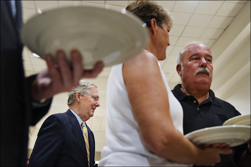 U.S. Senate Minority Leader Mitch McConnell talks with attendees before the 51st annual Kentucky Country Ham Breakfast at the state fair in Louisville, KY on Thursday, August 21, 2014. Photos by Brian Powers
