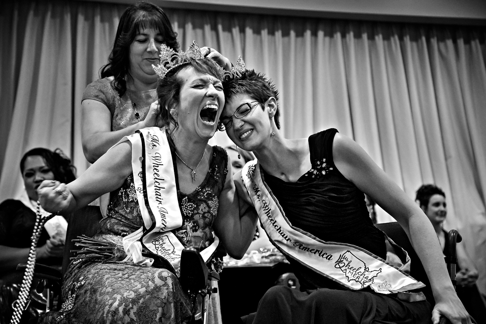 The new Ms. Wheelchair America, Dr. Alette Coble-Temple, left of California, celebrates with the outgoing Ms. Wheelchair America Samantha Schroth after Coble-Temple was named 2016 Ms. Wheelchair America at the Marriott in Downtown Des Moines on Saturday, August 1, 2015.