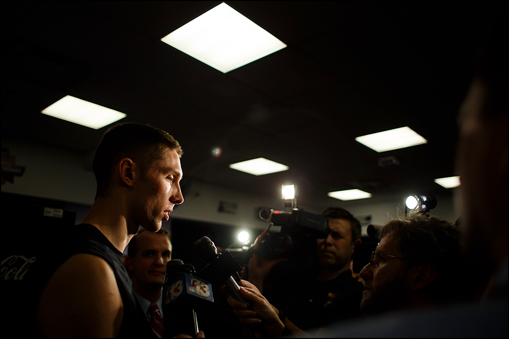 Iowa's Jarrod Uthoff (20) answers questions from the media in the team's locker room before taking the court for practice on Thursday, March 17, 2016 in New York City, New York.