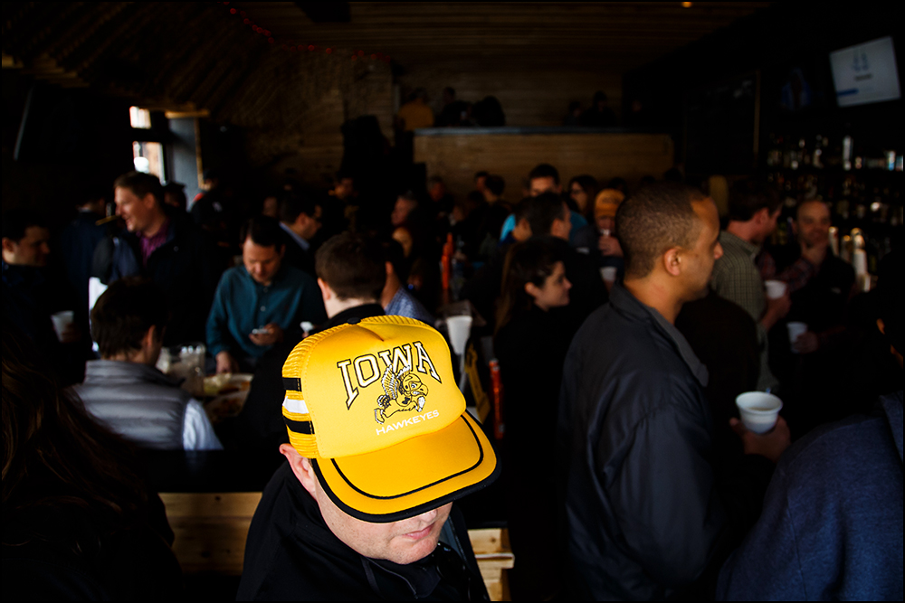 Iowa fans gather at The Montrose Bar in Brooklyn before the Hawkeyes take on Temple for their first round NCAA championship game on Friday, March 18, 2016.