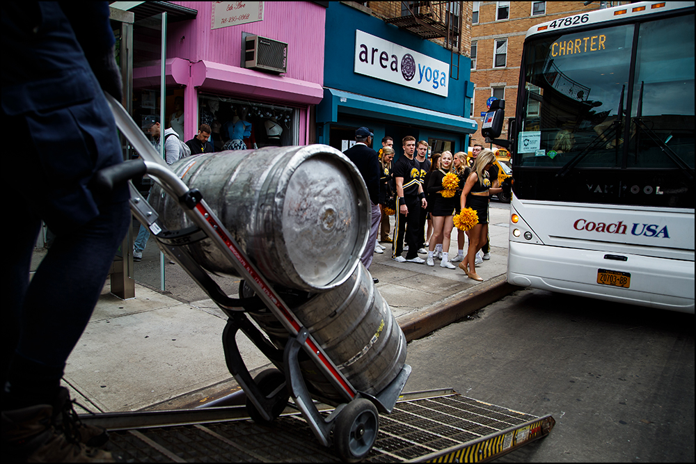 Members of the Iowa pep band and cheer squad return to their bus after greeting fans at The Montrose Bar in Brooklyn before the Hawkeyes take on Temple for their first round NCAA championship game on Friday, March 18, 2016.