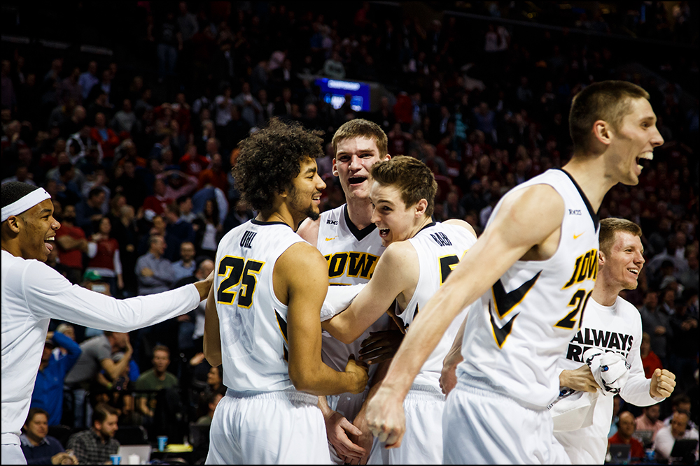 Iowa's Adam Woodbury (34) celebrates after hitting the game winning shot to put the Hawkeyes up 72-70 in overtime of their first round NCAA championship game on Friday, March 18, 2016 in New York City,New York.during their first round NCAA championship game on Friday, March 18, 2016 in New York City,New York.