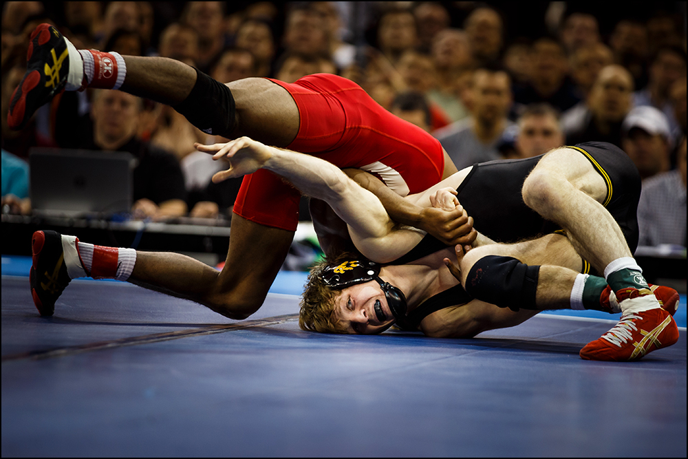 Iowa's Cory Clark wrestles Cornell's Nahshon Garrett during their NCAA championship bout on Saturday, March 19, 2016 in New York City, New York. Garrett would go on to win 7-6.