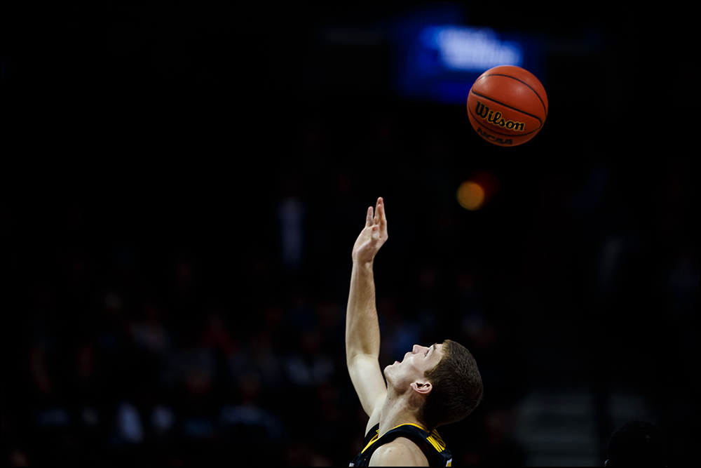Iowa's Adam Woodbury (34) looks up at the ball at tipoff during their second round NCAA Basketball Championship game against Villanova on Sunday, March 20, 2016 in New York City, New York.