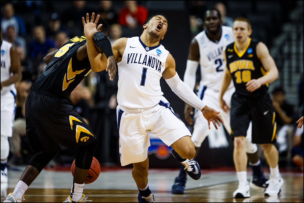 Iowa's Anthony Clemmons (5) fouls Villanova's Jalen Brunson during their second round NCAA Basketball Championship game on Sunday, March 20, 2016 in New York City, New York.