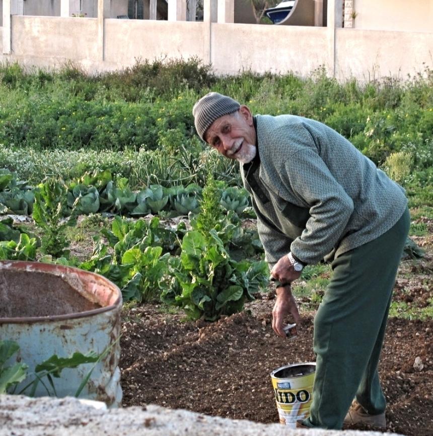 An elder tending plants in the village, North Lebanon.