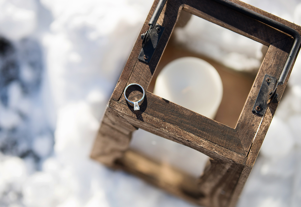 Engagement ring in snow at woodlawn manor