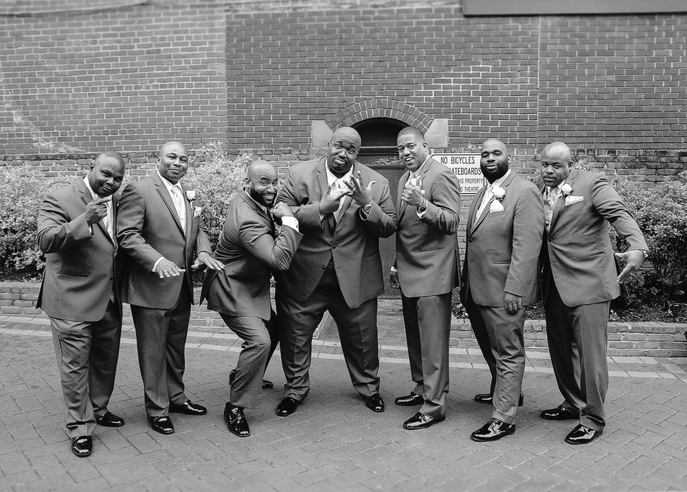 Groom and groomsmen wedding photos in downtown hagerstown maryland