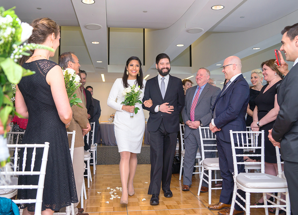 Bride being escorted by her brother down the aisle at GWU City View Room wedding