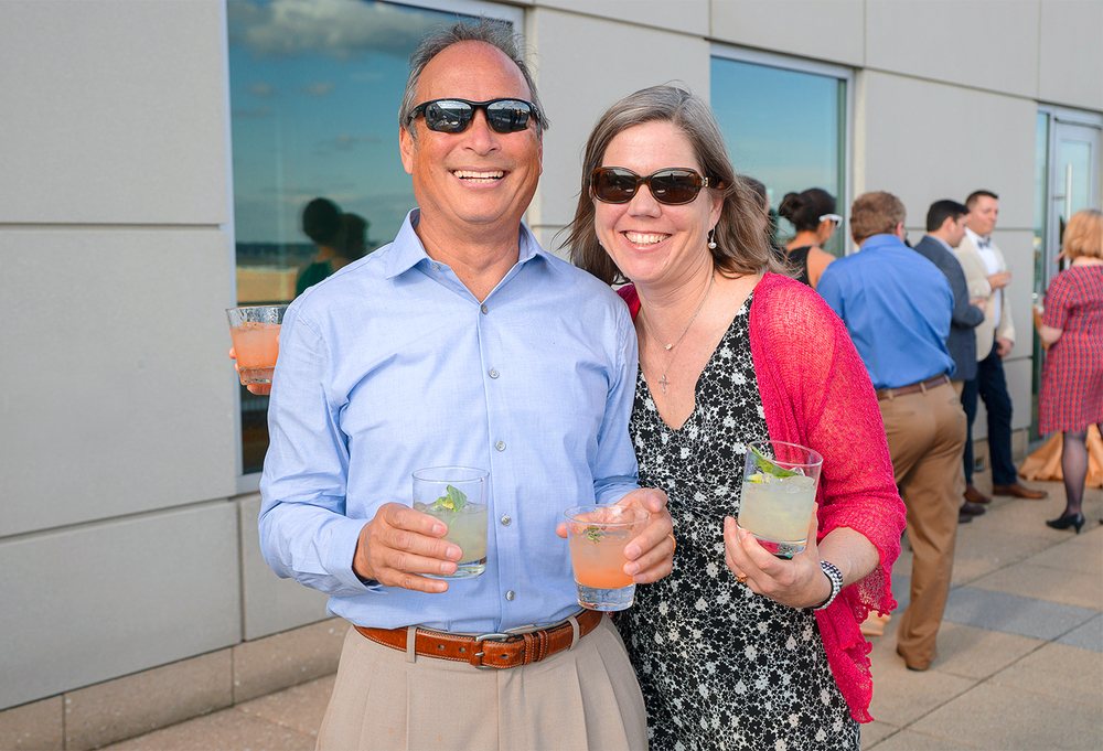 Guests at summer rooftop wedding