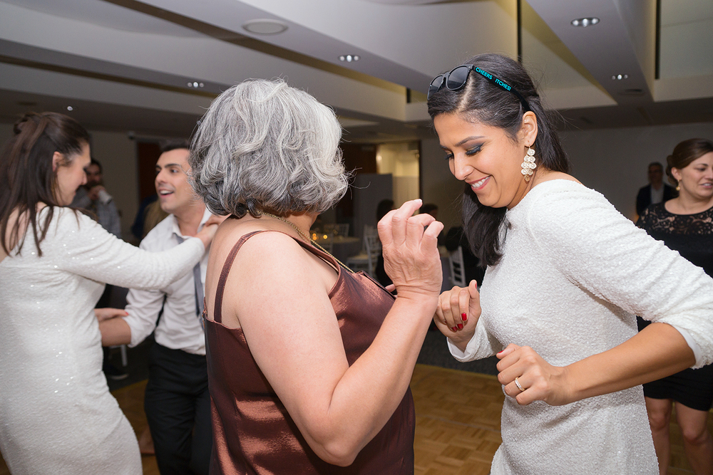 Bride and her mother dancing at the reception at GWU City View Room