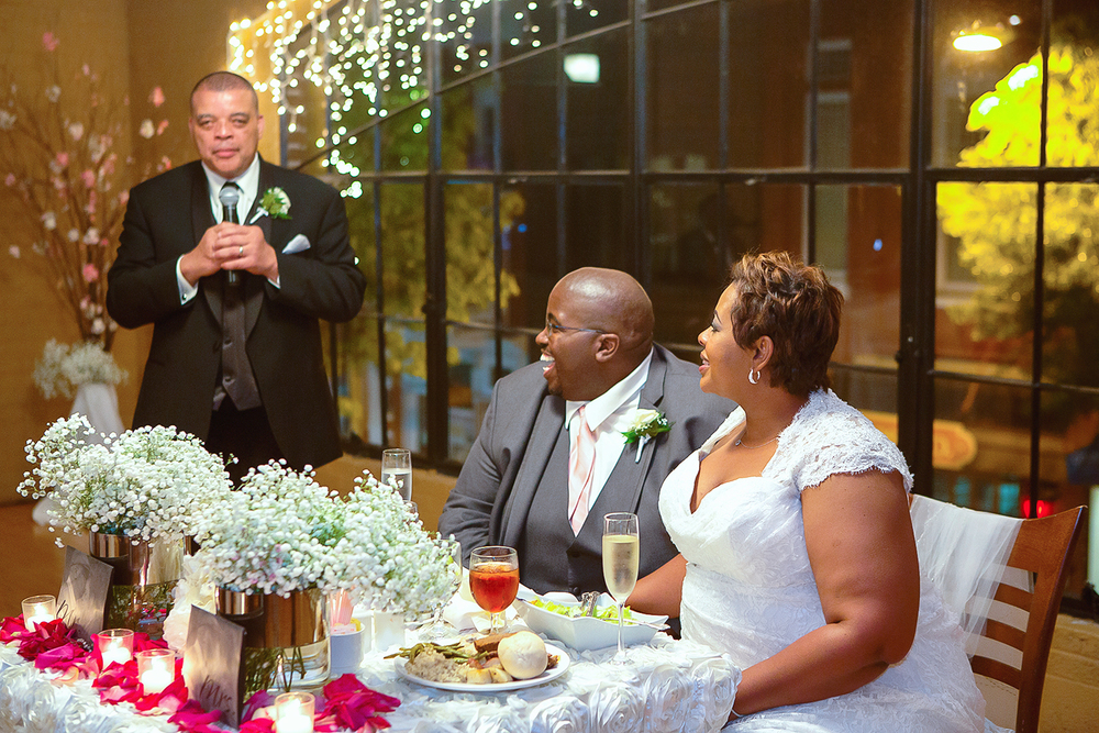 Bride and groom during wedding toasts at schindler rohrer ballroom in hagerstown