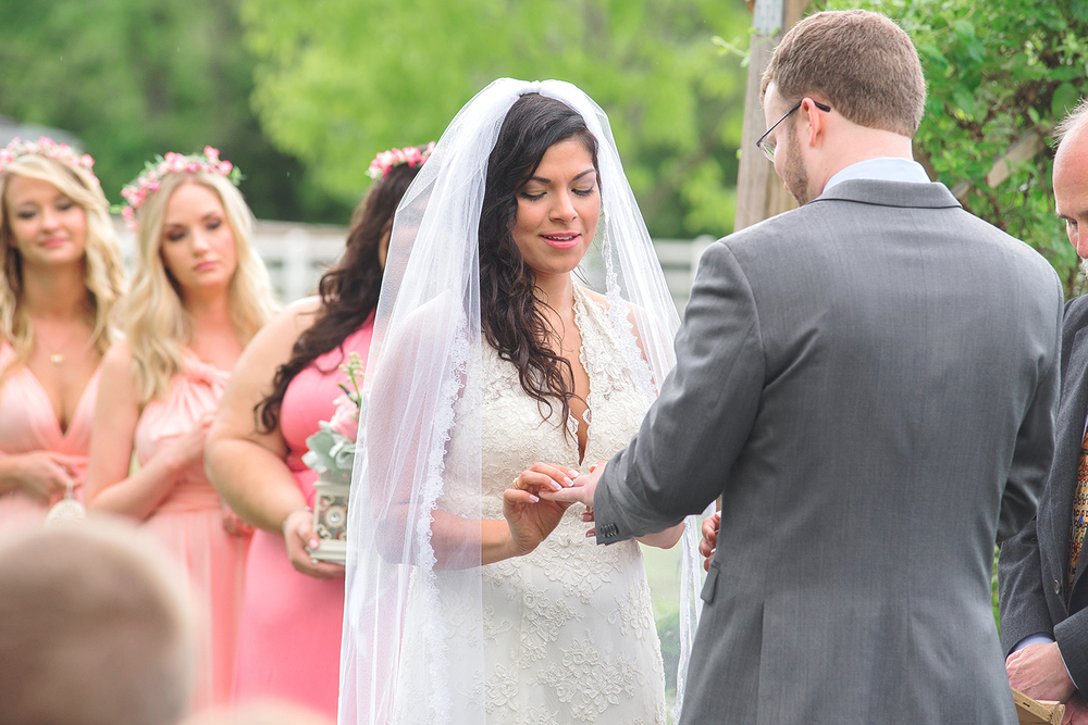 Rings and vows during wedding ceremony at Rosedale Manor at Greenwell State Park