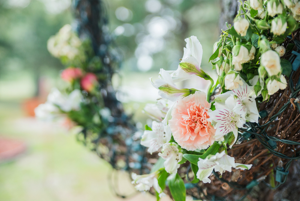DIY wedding flowers and wreath at backyard Idaho wedding
