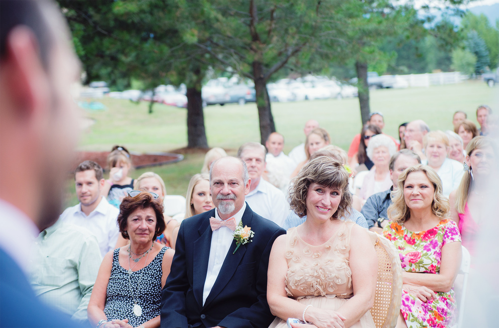 Emotional parents watching wedding ceremony in Idaho