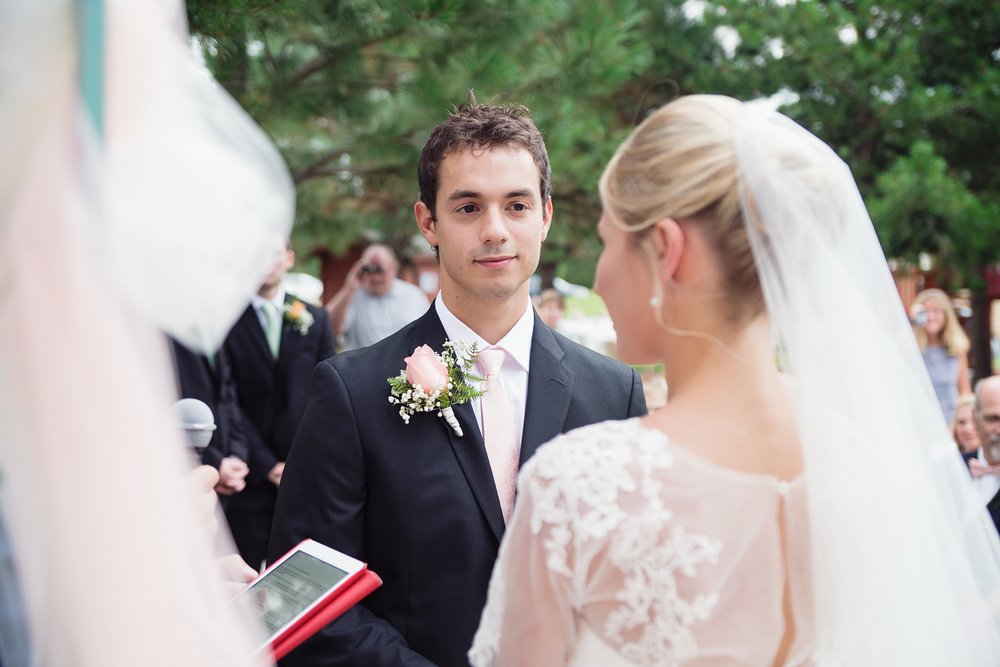 Groom looking at his bride during vows Idaho wedding ceremony
