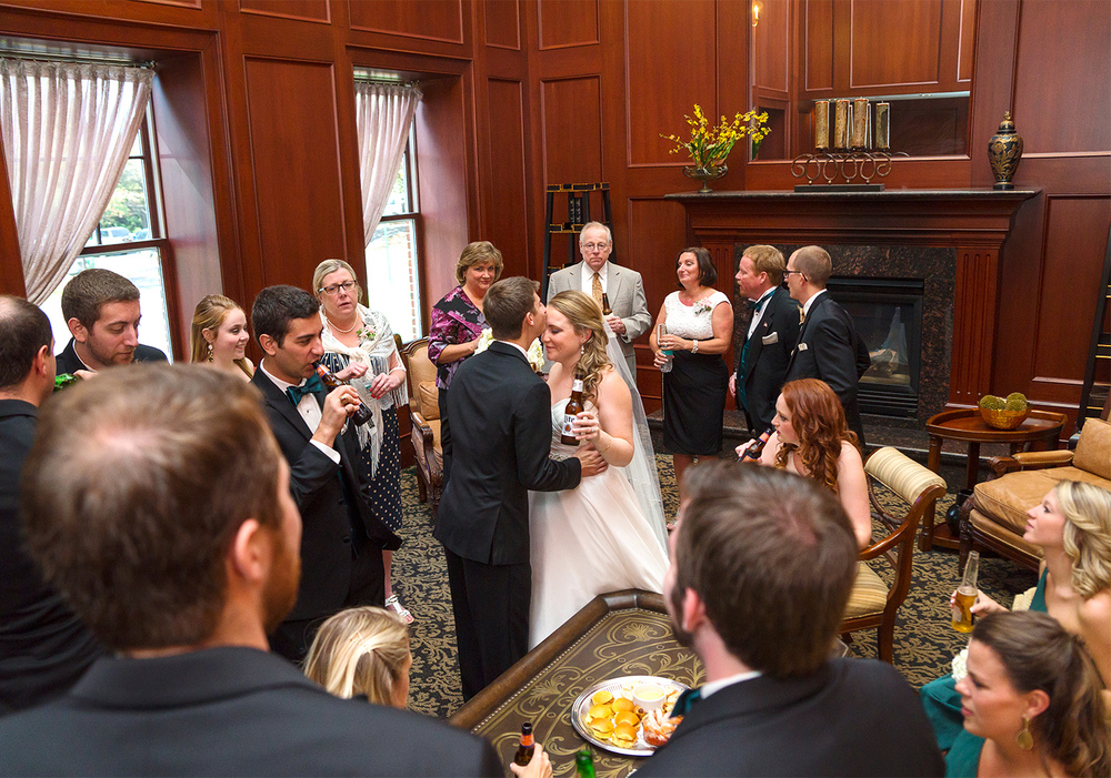 Bride and groom in library room at Springfield Country Club