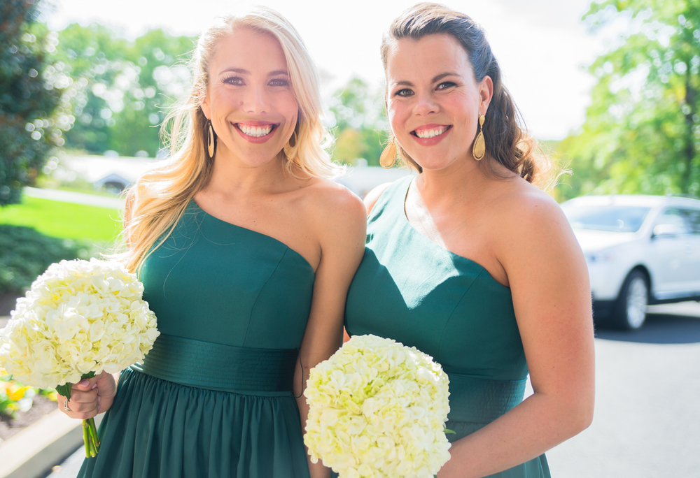 Bridesmaids in emerald green in front of Springfield Country Club