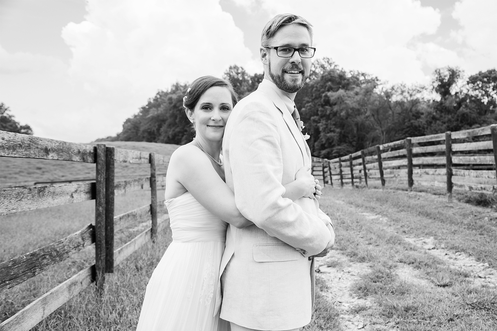 Bride and groom at horse farm barn wedding in baltimore maryland