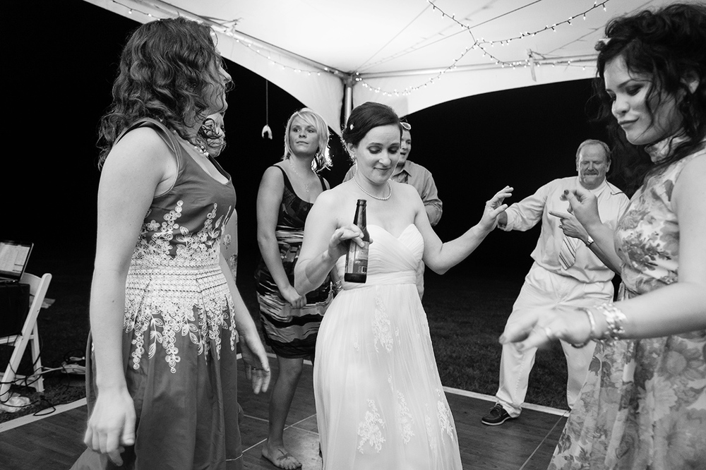 Bride and guests at tent wedding reception