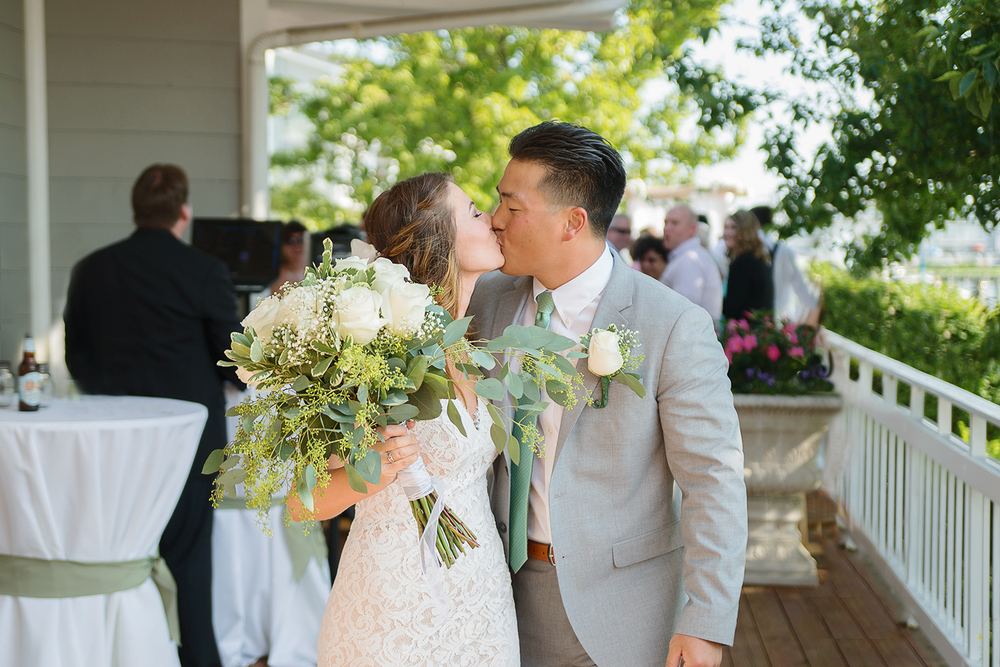 Bride and groom kiss after the wedding ceremony in annapolis