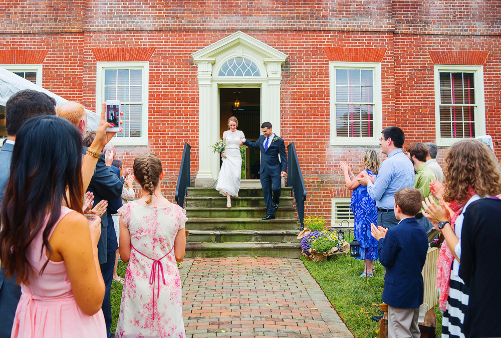 Bride and groom exit photos at montpelier mansion