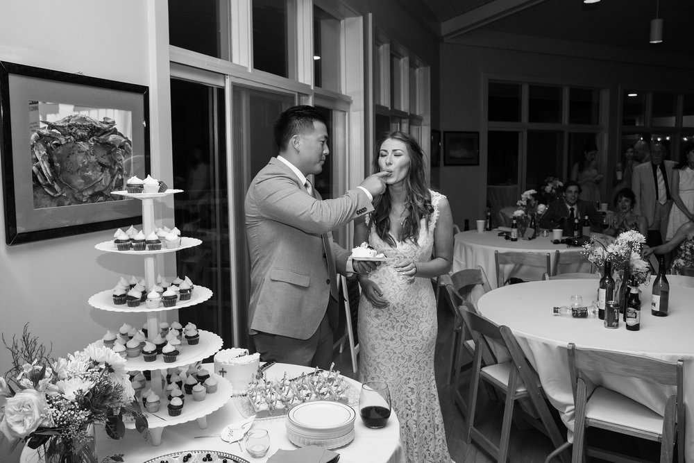 Cake cutting and groom feeding the bride